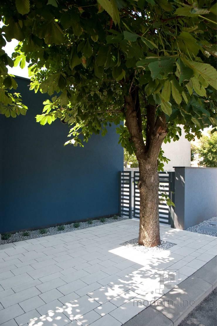 Nowoczesne nawierzchnie - taras i ogród: styl , w kategorii Ściany zaprojektowany przez Modern Line