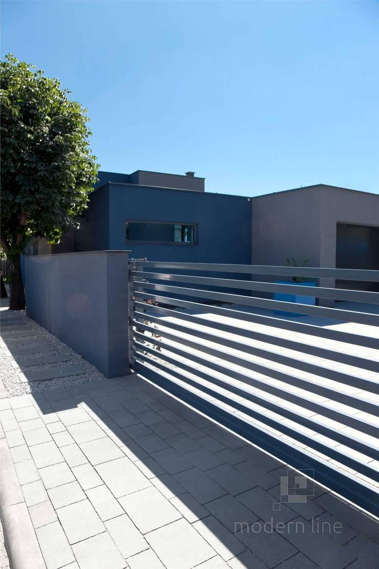 Nowoczesne nawierzchnie – taras i ogród: styl , w kategorii Ściany zaprojektowany przez Modern Line
