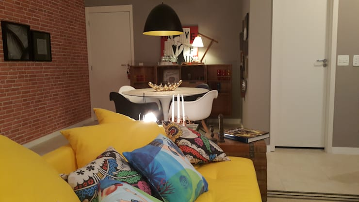 Detalhes integração estar e jantar: Sala de estar  por Lucio Nocito Arquitetura e Design de Interiores ,