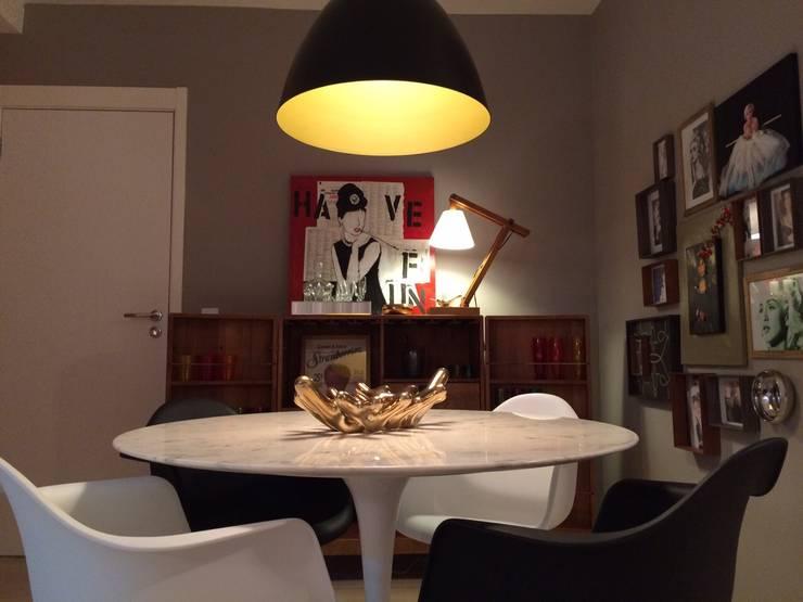 Sala de jantar aconchegante.: Sala de jantar  por Lucio Nocito Arquitetura e Design de Interiores