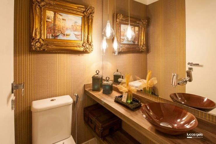 Apartamento: Banheiros  por Artenova Interiores