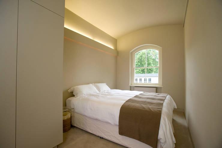 AFTER:  Bedroom by FALCHI INTERIORS LTD