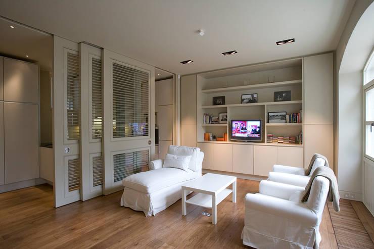 AFTER:  Living room by FALCHI INTERIORS LTD