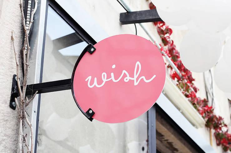 wish concept store: Escritório e loja  por Mergulhar na cidade, lda