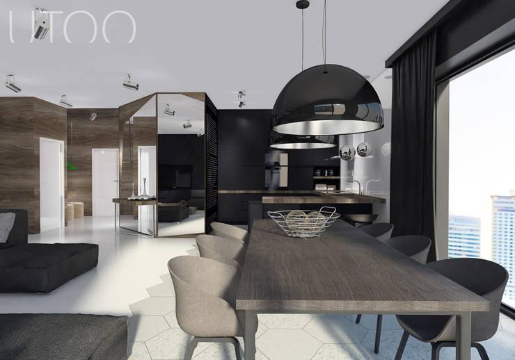 Projekt wnętrza w ciemnych barwach: styl , w kategorii Jadalnia zaprojektowany przez UTOO-Pracownia Architektury Wnętrz i Krajobrazu,Nowoczesny