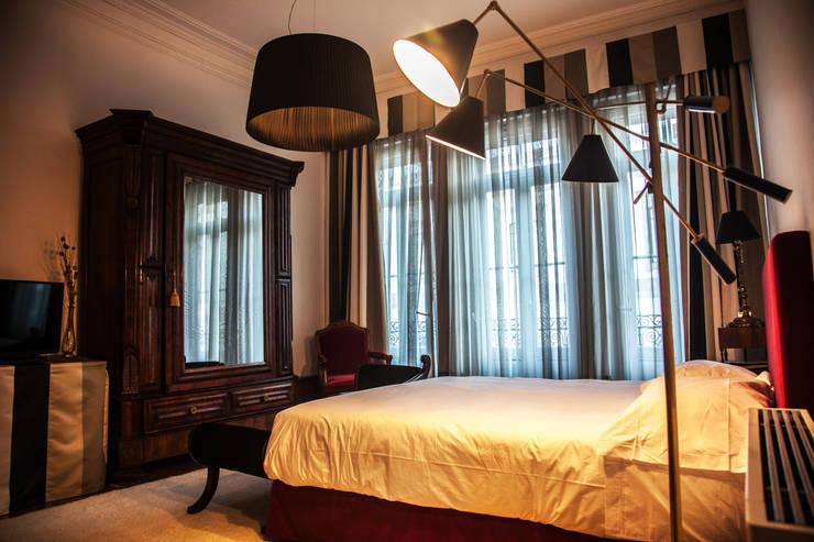 OPORTO LOFT - ART HOTEL | OPORTO | PORTUGAL: Quartos ecléticos por Bastos & Cabral - Arquitectos, Lda. | 2B&C