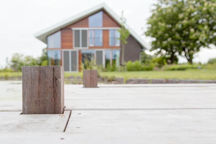 Vaste planten tuin in Houten:  Huizen door Mocking Hoveniers