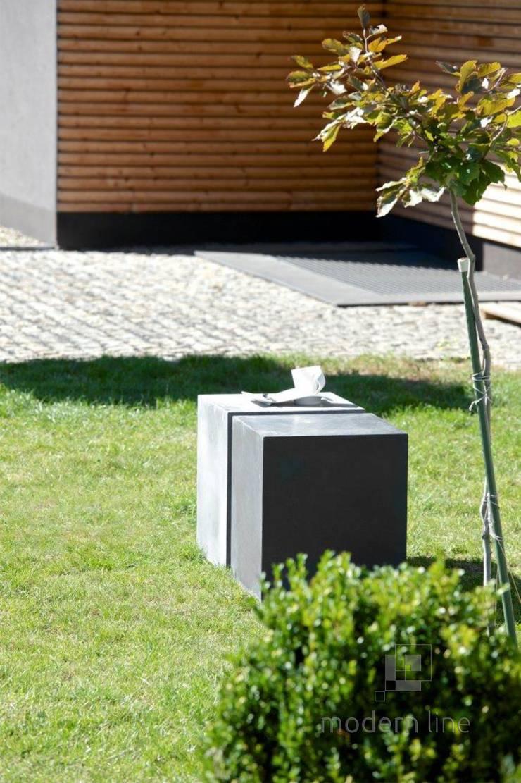 Betonowy detal w przestrzeni publicznej: styl , w kategorii Hotele zaprojektowany przez Modern Line