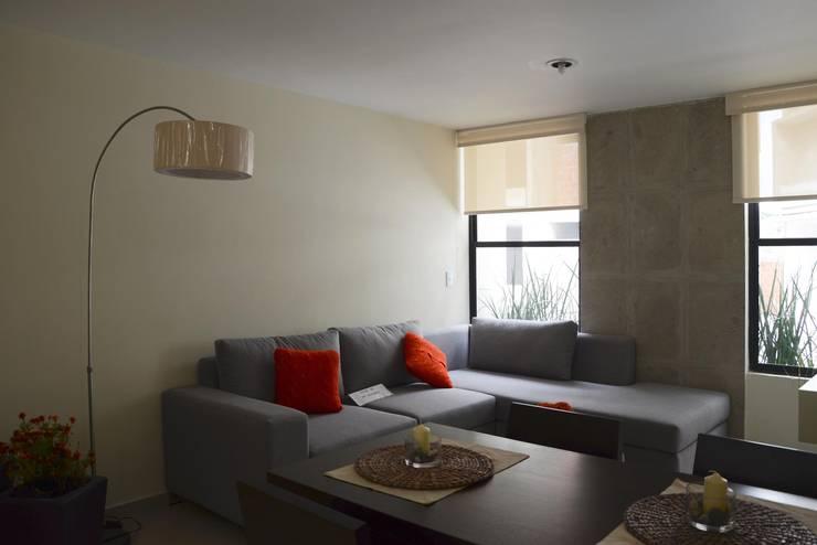 Privalia Sur: Salas de estilo  por PABELLON de Arquitectura