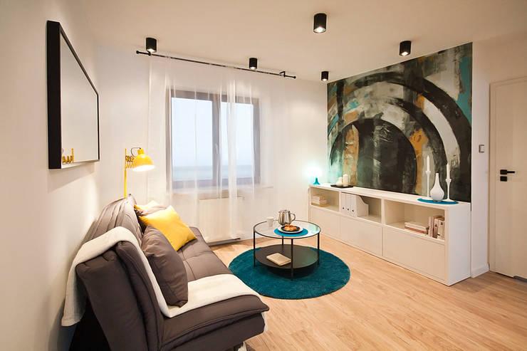 PRZESTRONNY APARTAMENT: styl , w kategorii Salon zaprojektowany przez IDAFO projektowanie wnętrz i wykończenie,