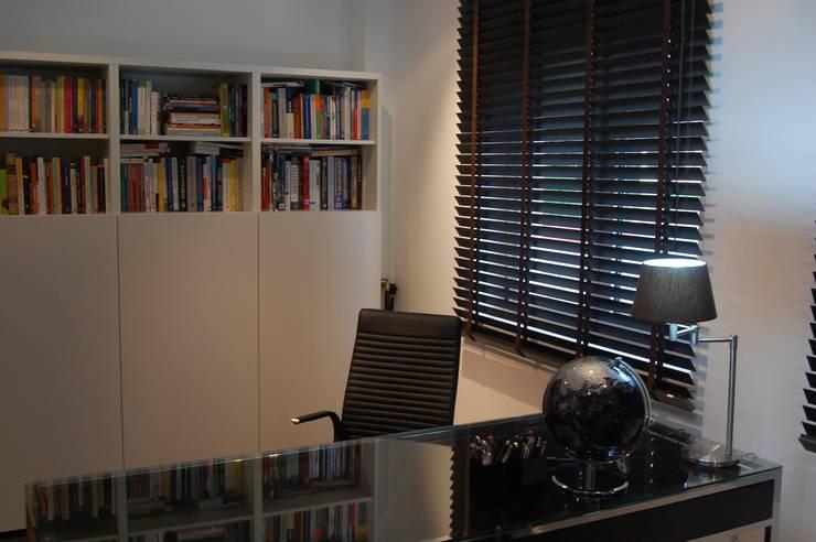 MORADIA RIBEIRINHA: Escritórios e Espaços de trabalho  por Critério Arquitectos by Canteiro de Sousa