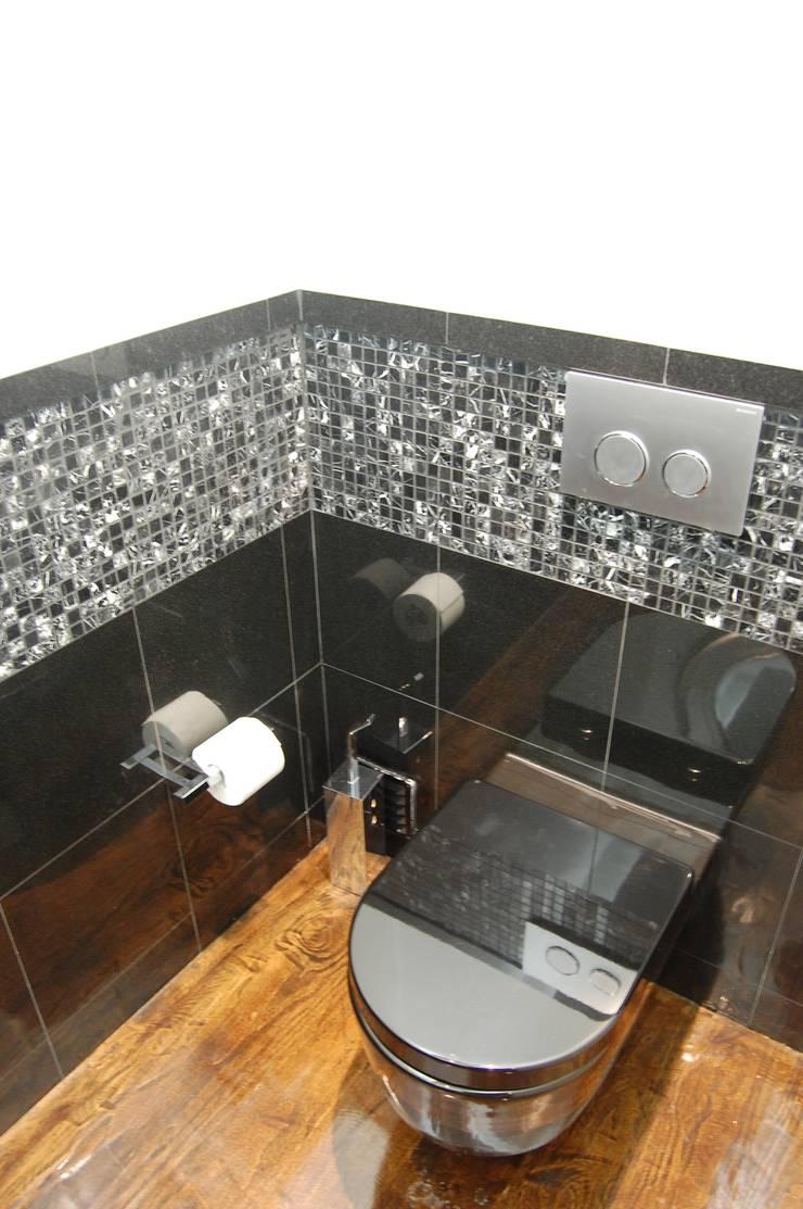 MORADIA RIBEIRINHA: Casas de banho  por Critério Arquitectos by Canteiro de Sousa
