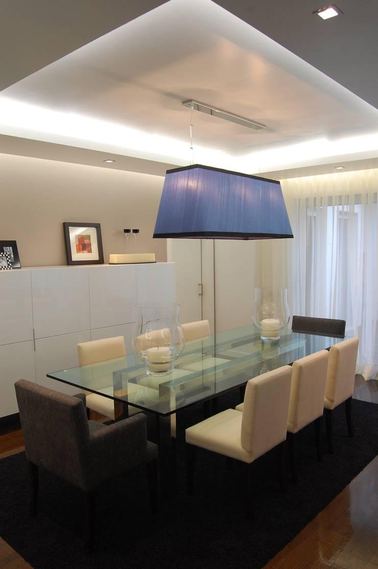 MORADIA RIBEIRINHA: Salas de jantar  por Critério Arquitectos by Canteiro de Sousa