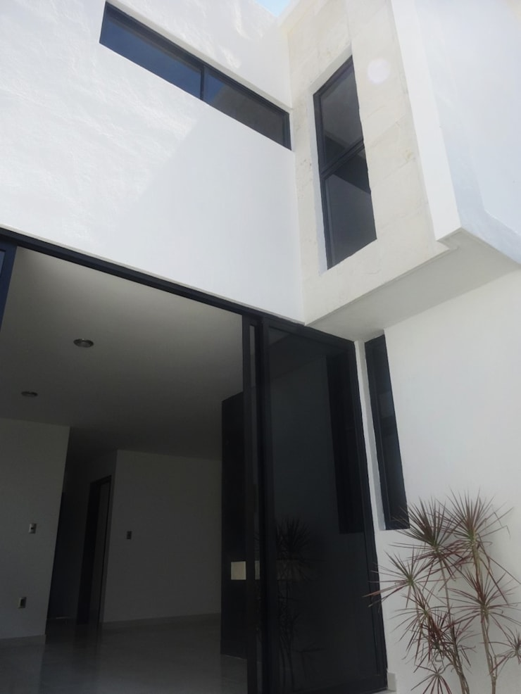 Fachada Posterior: Casas de estilo  por CONSTRUCTORA ARQOCE