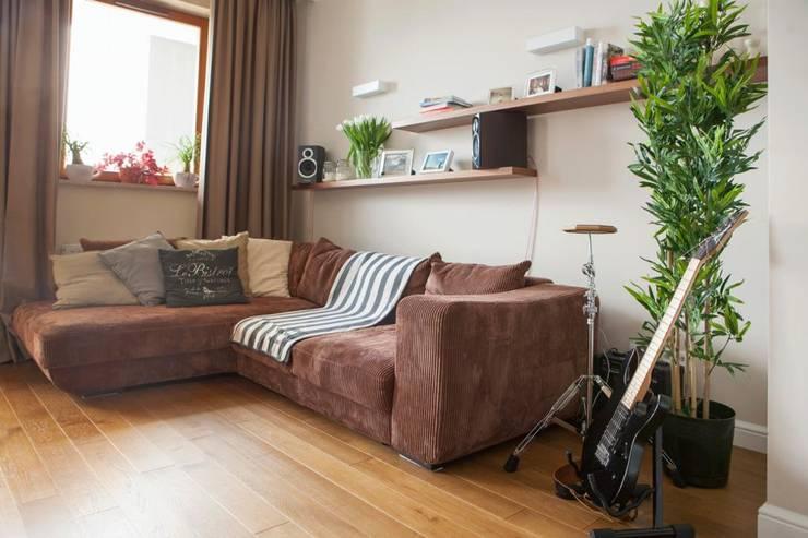 Realizacja 11: styl , w kategorii Salon zaprojektowany przez MGN Pracownia Architektoniczna,