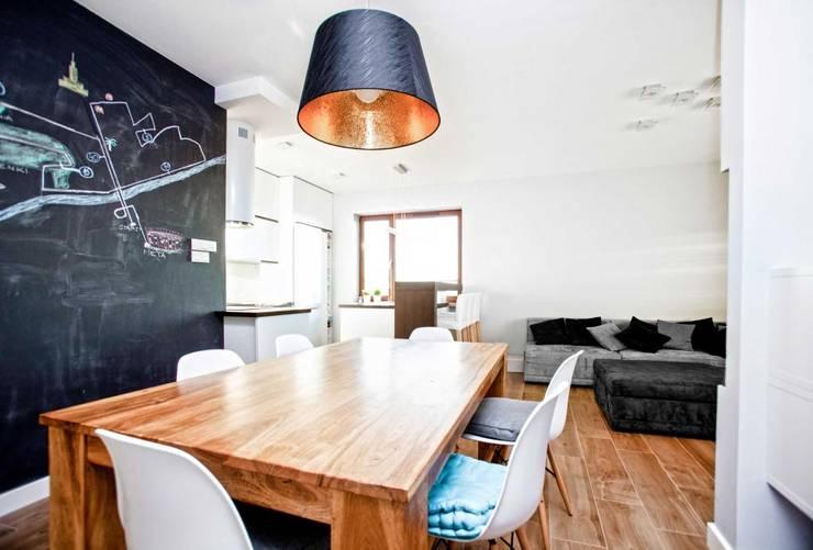 Realizacja 8: styl , w kategorii Jadalnia zaprojektowany przez MGN Pracownia Architektoniczna,Nowoczesny