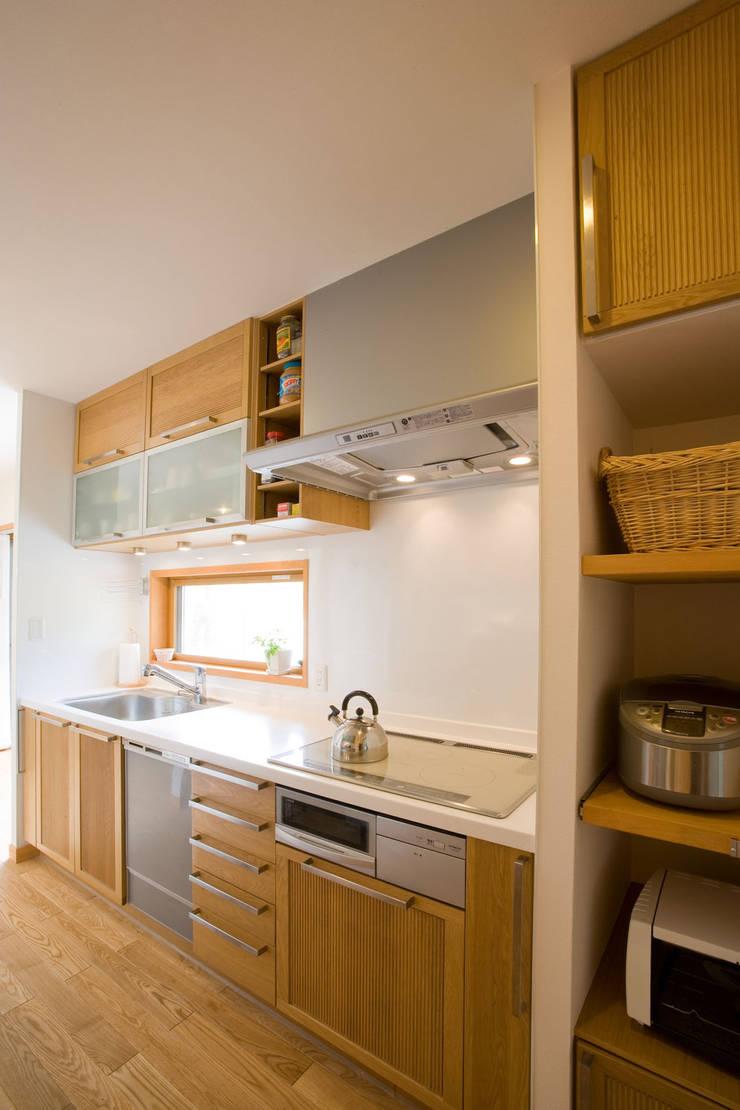 五條の家: 株式会社 atelier waonが手掛けたキッチンです。