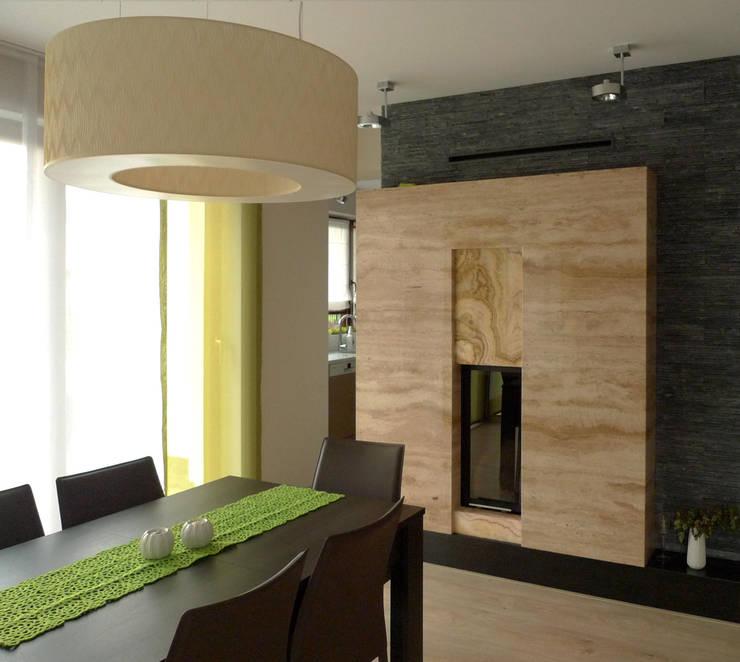 salon i kominek : styl , w kategorii Jadalnia zaprojektowany przez Archomega