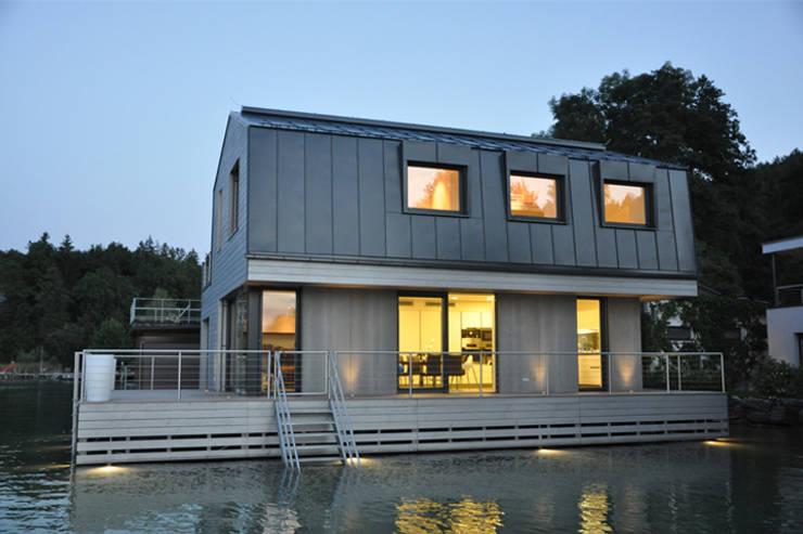 Haus am See: moderne Häuser von kilian gartner architektur