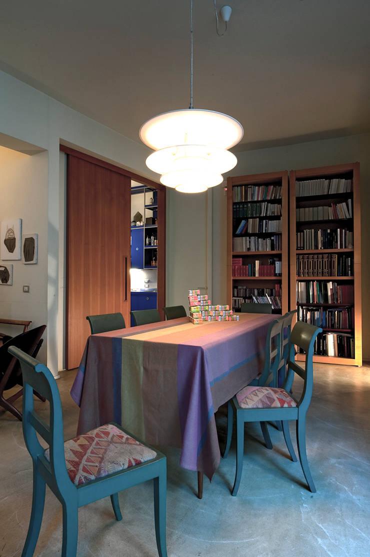 Salle à manger de style  par Bongiana Architetture, Moderne