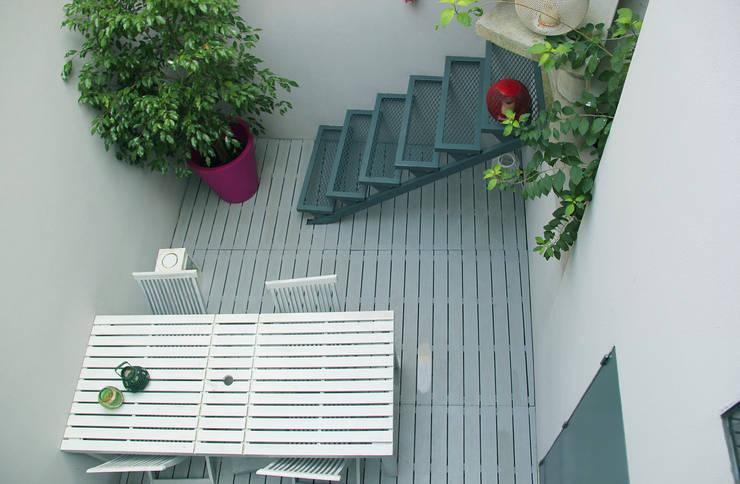 Jardines de estilo  por MOOPI - Arch + Interiors