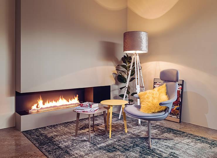 Fire Line Automatic XT by Planika: styl , w kategorii Korytarz, hol i schody zaprojektowany przez Planika Fires