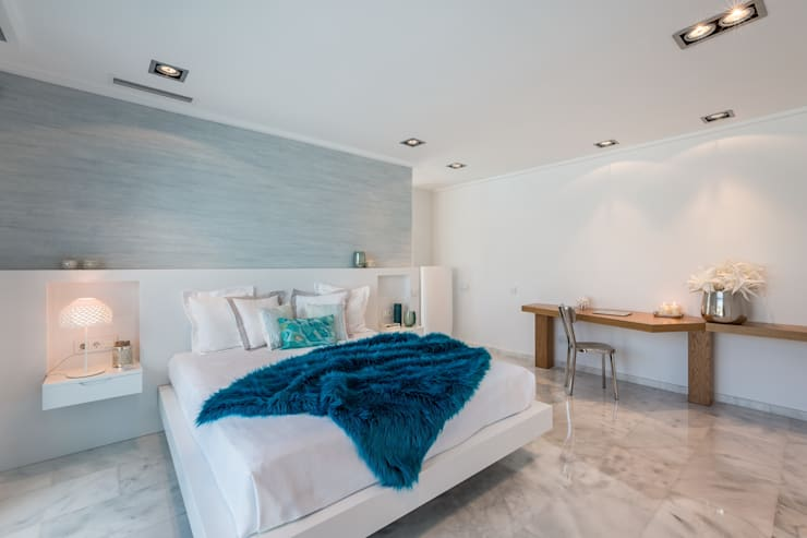 Dormitorio de inspiración mediterránea: Dormitorios de estilo mediterráneo de Laura Yerpes Estudio de Interiorismo