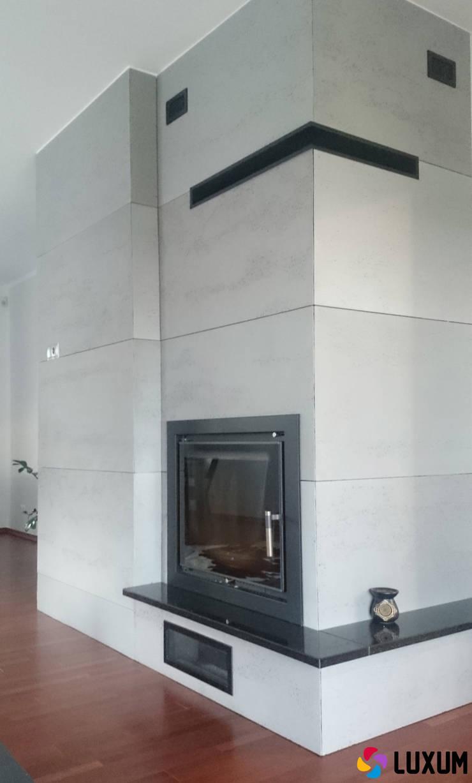Komienek z betonu architektonicznego: styl , w kategorii Salon zaprojektowany przez Luxum,