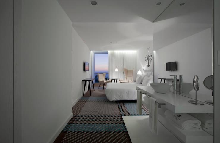 Maçarico Beach Hotel by Ipotz Studio: Hotéis  por Ipotz Studio