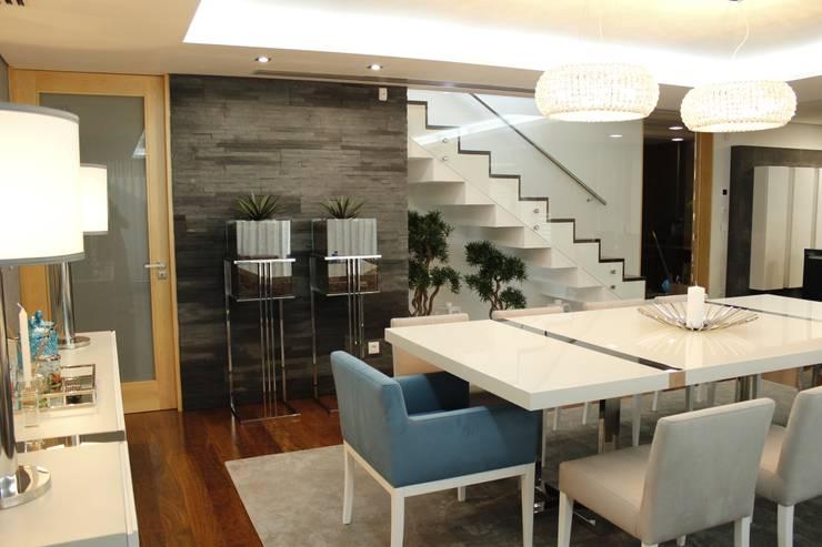 Home sweet home: Salas de jantar  por Grupo HC