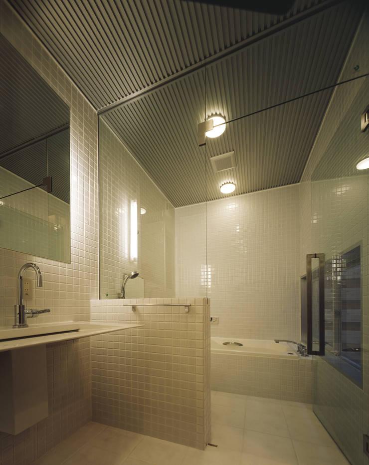 バスルーム: atelier mが手掛けた浴室です。,