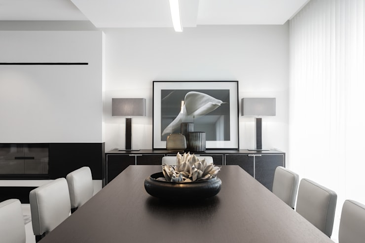Dining room by CASA MARQUES INTERIORES