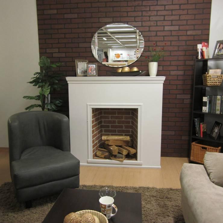 Sala chimenea: Salas de estilo  por Idea Interior