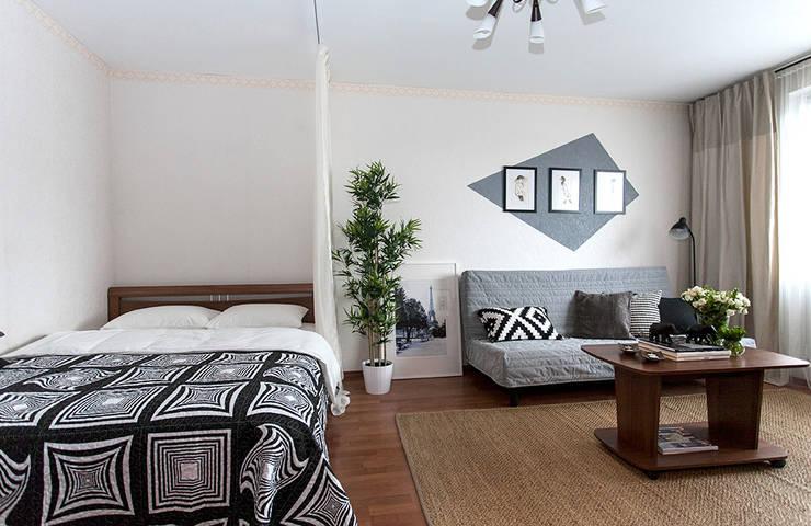 Однокомнатная квартира в Москве: Гостиная в . Автор – L'Essenziale Home Designs