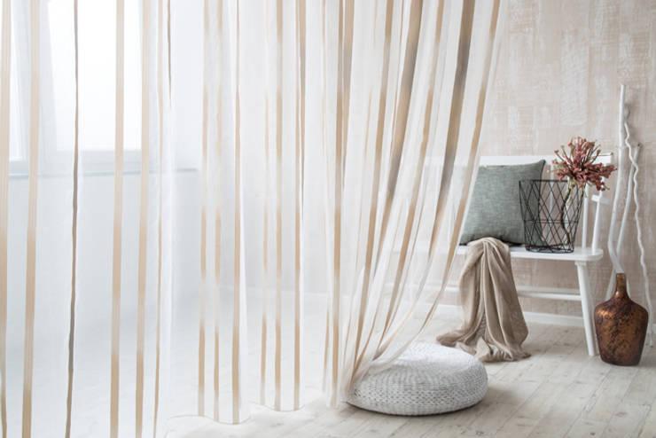 Indes Fuggerhaus Textil GmbHが手掛けたリビングルーム