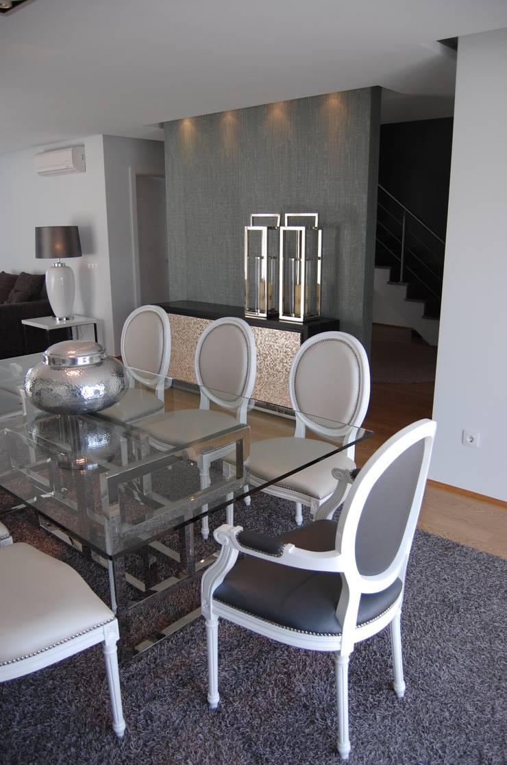 Moradia familiar : Salas de jantar  por Critério Arquitectos by Canteiro de Sousa