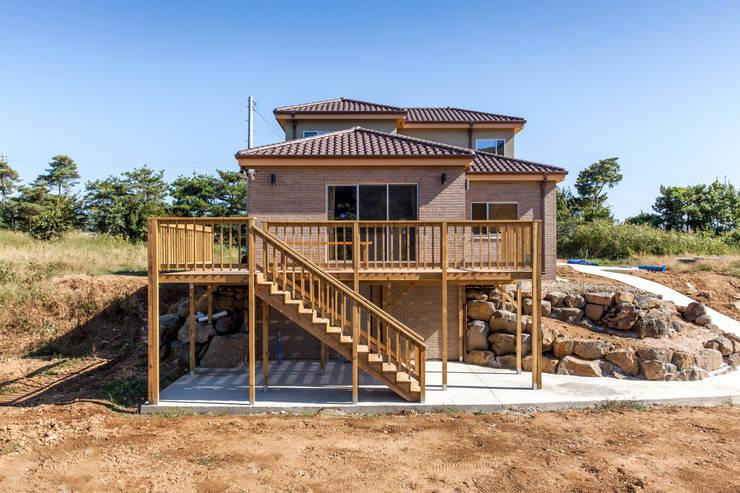 Casas de estilo  por woodsun