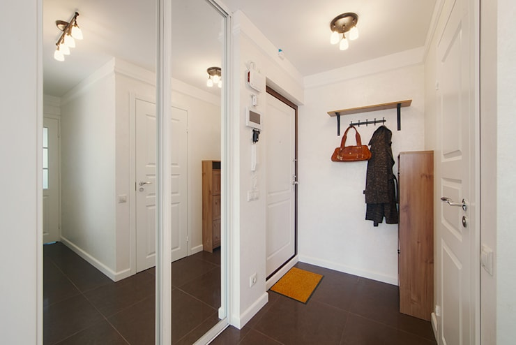 Маленькая квартира для аренды: Коридор и прихожая в . Автор – Порядок вещей - дизайн-бюро, Скандинавский