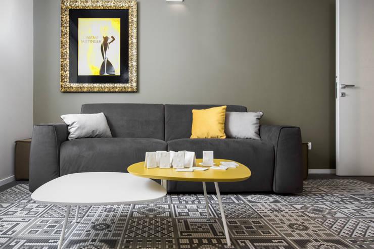 Livings de estilo  por Studio Andrea Castrignano