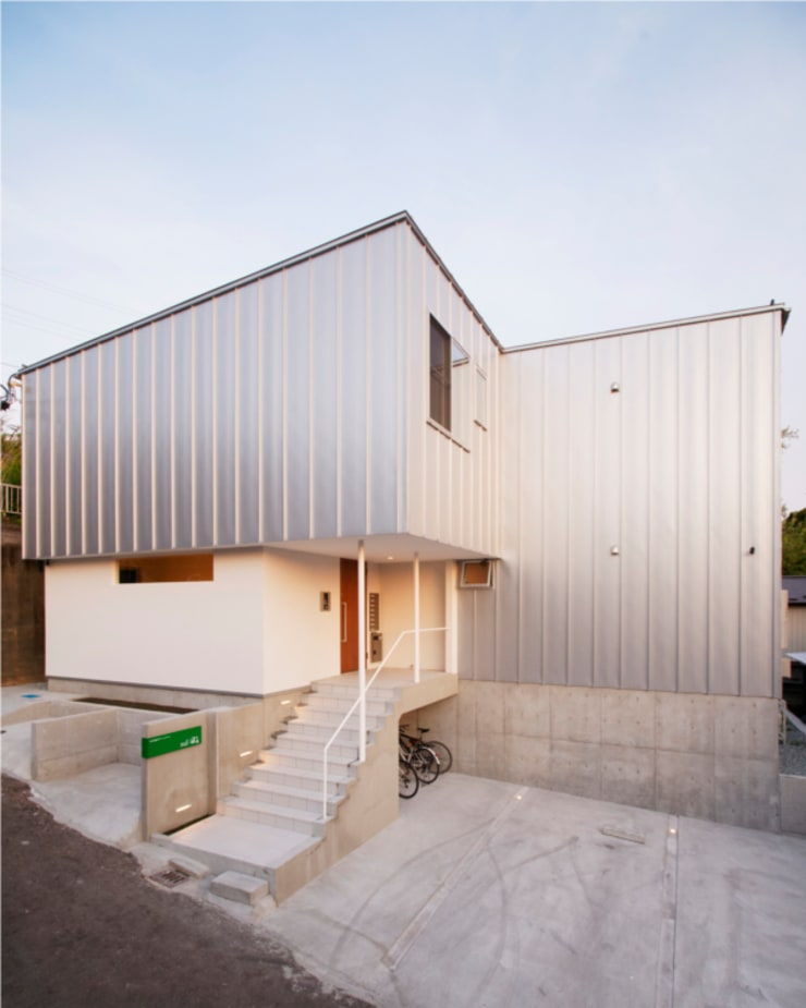 もりの丘アパートメント: 大類真光建築設計事務所が手掛けた家です。