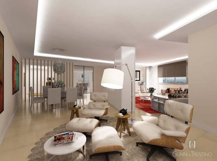 Proyecto de residencia unifamiliar moderna: Salones de estilo  de GUNNI & TRENTINO