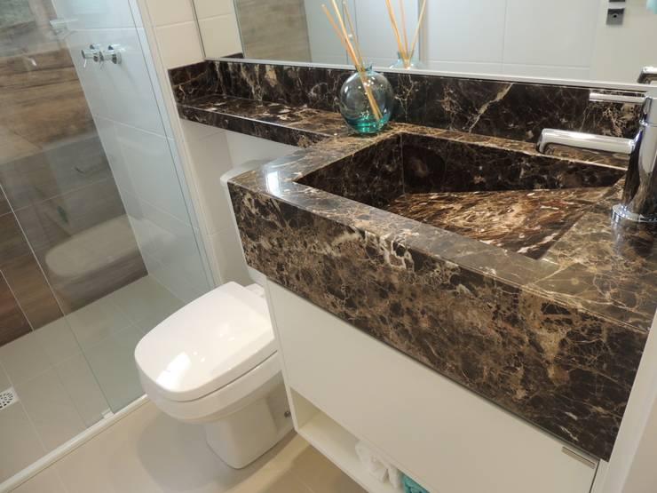 Lavabo: Banheiros  por Cembrani móveis