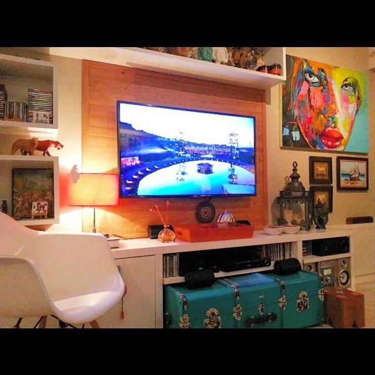 Detalhes sala de estar. : Salas de estar ecléticas por Lucio Nocito Arquitetura e Design de Interiores