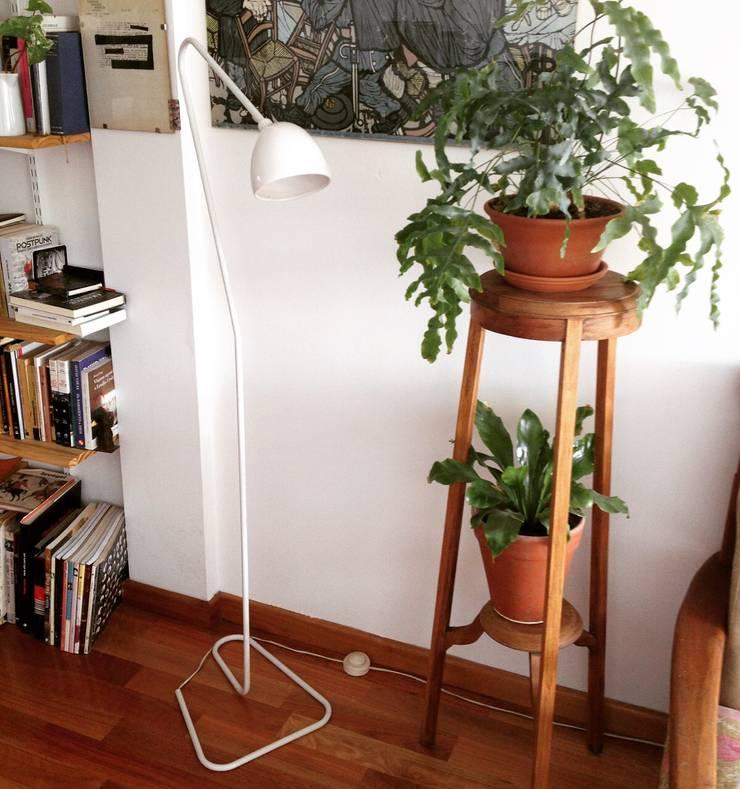 Usos: Livings de estilo  por A3 diseño sa