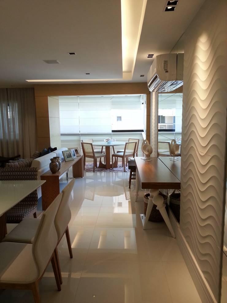 Detalhes do living por Lucio Nocito Arquitetura.: Salas de jantar  por Lucio Nocito Arquitetura e Design de Interiores