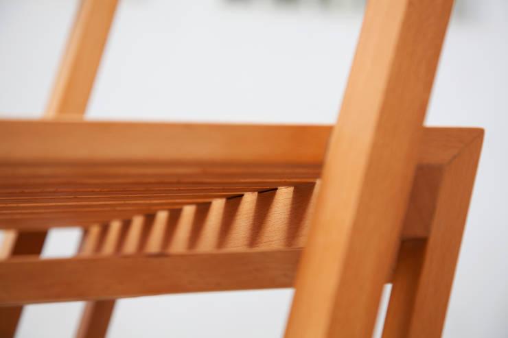 Silla 70º: Hogar de estilo  por Nineteen Hundred
