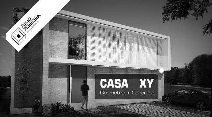 Casa XY: Casas modernas por Julio Ferreira Arquitetura