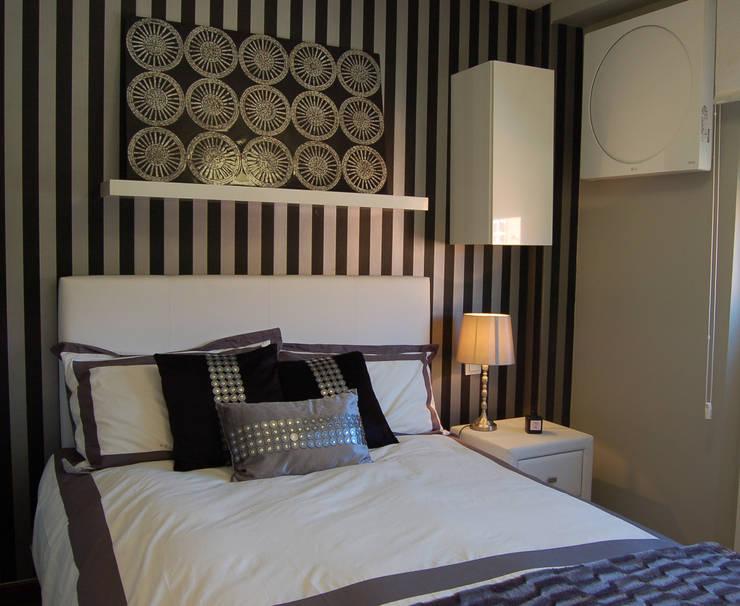 Vivienda en Getafe, Madrid: Dormitorios de estilo  de Arquitectura de Interior
