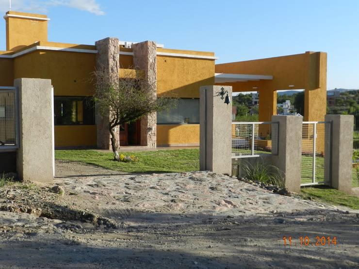 Huizen door ART quitectura + diseño de Interiores. ARQ SCHIAVI VALERIA