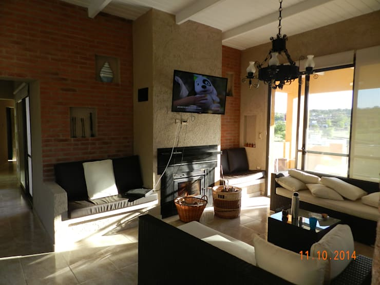 Livings de estilo  por ART quitectura + diseño de Interiores. ARQ SCHIAVI VALERIA
